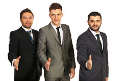 Team of business men giving handshakes Royalty Free Stock Photos
