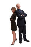 The A Team - business partners. Image of two business people in a 'charlies angels' or 'A team' stance, conceptual kick ability stock photos