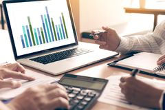 Team business people analysis summary report graph on laptop in office room royalty free stock images
