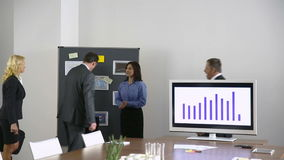 Team of business people in conference room stock footage