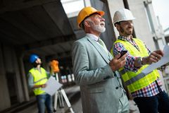 Team of business people in group, architect and engeneer on building site check documents stock photo