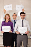 Team of business people holding card boards Royalty Free Stock Photo
