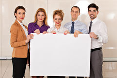 Team of business people holding cardboard Stock Image