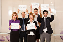 Team of business people holding cardboards Royalty Free Stock Photography