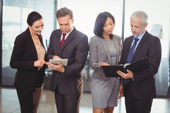 Team of business people interacting Royalty Free Stock Photography
