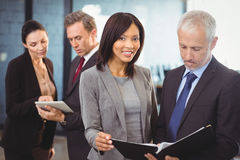 Team of business people interacting Stock Image