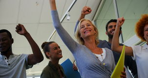 Team of business people jumping in office. Team of excited business people jumping in office stock video
