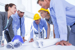 Team of business people looking at construction plan Royalty Free Stock Photos