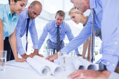 team of business people looking at construction plan Royalty Free Stock Images