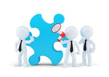 Team of business people and piece of a puzzle Royalty Free Stock Photography