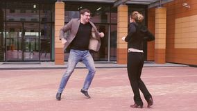 Team of business people rejoicing and celebrates success. man give five near the modern business center. Man and woman. Two businessmen are having fun and stock footage