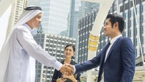 Team of  business people smart man and woman talk and shake hand Royalty Free Stock Photography