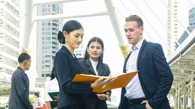 Team of business people smart man and woman talk Stock Photos