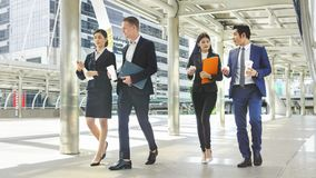 Team of business people smart man and woman walk in rush hour Stock Photo