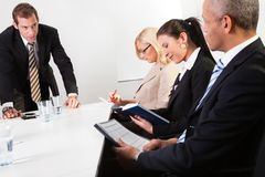 Team of business people taking notes Royalty Free Stock Image