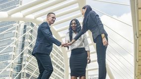 Team of business people talk and join hand in good feeling at ou Stock Image