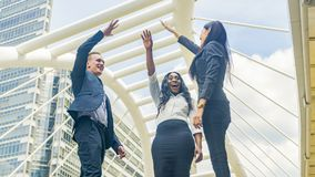 Team of business people talk and join hand in good feeling at outdoor pedestrian walk way royalty free stock photo