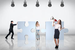 Team of business people try to join puzzle Royalty Free Stock Photos