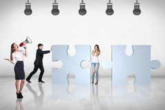 Team of business people try to join puzzle Stock Images