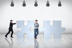 Team of business people try to join puzzle Royalty Free Stock Image