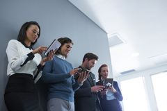 Team of business people using electronic devices Royalty Free Stock Image