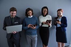 Team of business people using electronic devices Royalty Free Stock Images