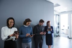 Team of business people using electronic devices Stock Photo