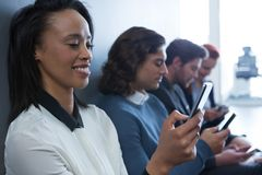Team of business people using mobile phone Stock Photography