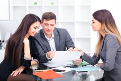 Team Of Business People Working In Office. Team Of Business People Working In Office Stock Photo