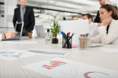 Team of business person works together on company statistics. Concept of teamwork Royalty Free Stock Image