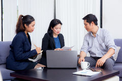 Team of business three people working together on a laptop Stock Photography