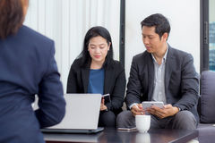 Team of business three people working together on a laptop. Royalty Free Stock Image