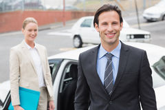 Team of businessman smiling at camera Stock Photos