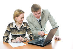 Team businessman and woman work on laptop Stock Photography