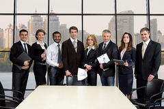 Team of businessmen in the business center. stock image