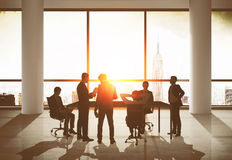 Team of businessmen in office. Team of businessmen in suits discussing something at meeting. New York city at background. Toned image Royalty Free Stock Photos