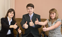 Team of businessmen show thumb up Stock Photos