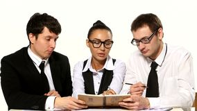 Team of businessmen are talks on a white stock footage