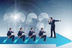 The team of businessmen in teamwork concept with boat Royalty Free Stock Photography