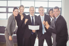 Team of businesspeople with certificate. Team of happy businesspeople with certificate in the office Stock Image