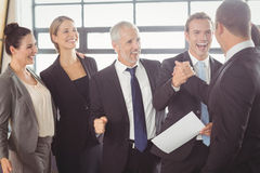 Team of businesspeople with certificate royalty free stock photos