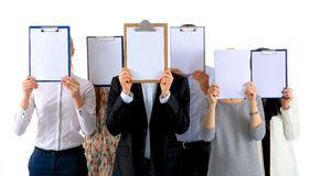 Team of businesspeople holding a folders near face Stock Photos
