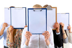 Team of businesspeople holding a folders near face Stock Images