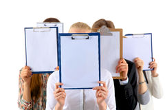 Team of businesspeople holding a folders near face Royalty Free Stock Photo