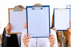 Team of businesspeople holding a folders near face Stock Image