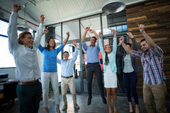 Team of businesspeople jumping in office Royalty Free Stock Images