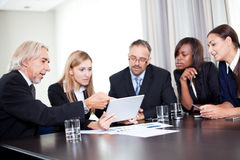 Team of businesspeople working together discussing Royalty Free Stock Photo
