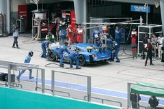 Team Calsonic Nissan car 12 at the pit stop Stock Photo