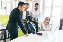 Team of casual business meeting to discuss ideas and computer on table in office royalty free stock photo