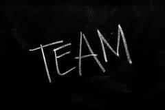 Team on Chalkboard. Handwritten chalk text Team on the blackboard royalty free stock photos